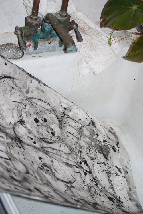 Getting ready to wash the Sumi black ink off in the sink.