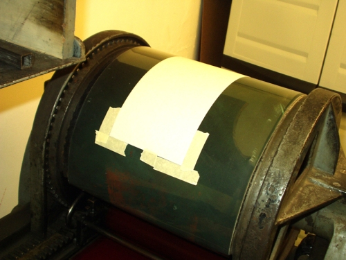 masking tape is used to mark the four corners whers the paper should sit.