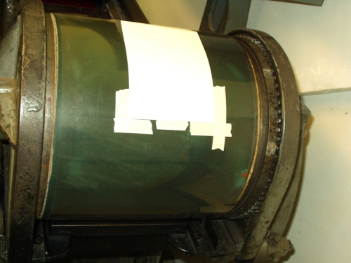 tape is placed on the drum to mark where the paper should sit